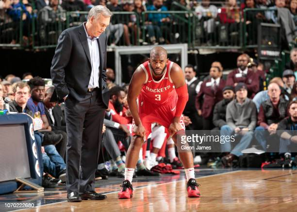 Head Coach Mike D'Antoni and Chris Paul of the Houston Rockets talk during a game against the Dallas Mavericks on December 8 2018 at the American...