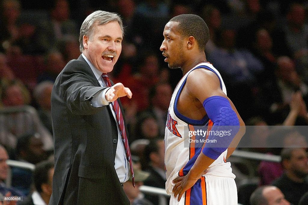 Head coach Mike D'Antoni coaches Chris Duhon #1 of the New York Knicks against the San Antonio Spurs at Madison Square Garden on February 17, 2009 in New York City.