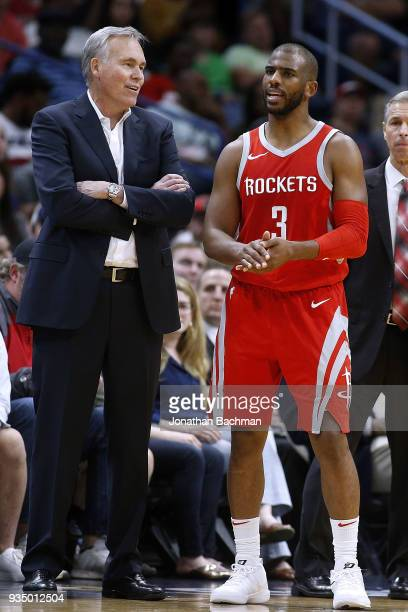 Head coach Mike D'Antoni of the Houston Rockets and Chris Paul talk during the second half against the New Orleans Pelicans at the Smoothie King...