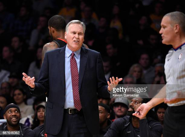 Head coach Mike D'Antoni of the Houston Rockets complains to referee Monty McCutchen during the first half of the basketball game against Los Angeles...