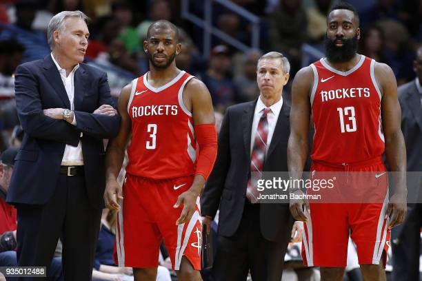Head coach Mike D'Antoni of the Houston Rockets James Harden and Chris Paul talk during the second half against the New Orleans Pelicans at the...