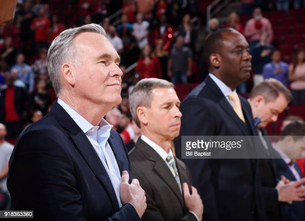 Head Coach Mike D'Antoni of the Houston Rockets stands for the National Anthem before the game against the Sacramento Kings on February 14 2018 at...