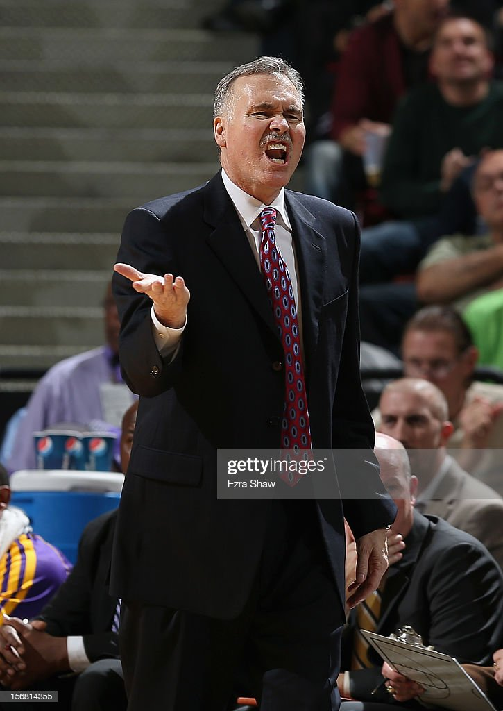 Head coach Mike D'Antoni of the Los Angeles Lakers argues with the referee during their game against the Sacramento Kings at Power Balance Pavilion on November 21, 2012 in Sacramento, California.