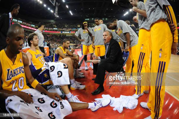 Head Coach Mike D'Antoni of the Los Angeles Lakers calls a play against the Golden State Warriors during the 2013 Global Games on October 15, 2013 at...