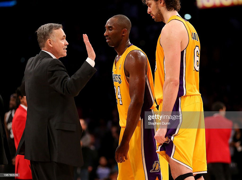 Head coach Mike D'Antoni of the Los Angeles Lakers celebrates with Kkobe Bryant #24 and Pau Gasol #16 after the game against the Brooklyn Nets at Staples Center on November 20, 2012 in Los Angeles, California. The Lakers won 95-90.