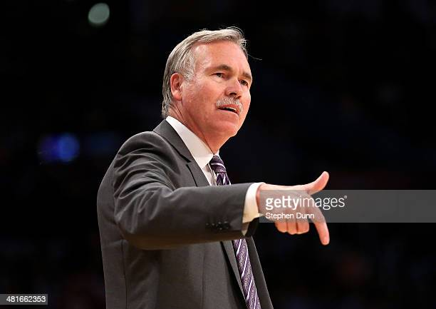 Head coach Mike D'Antoni of the Los Angeles Lakers gestures during the game with the Phoenix Suns at Staples Center on March 30 2014 in Los Angeles...