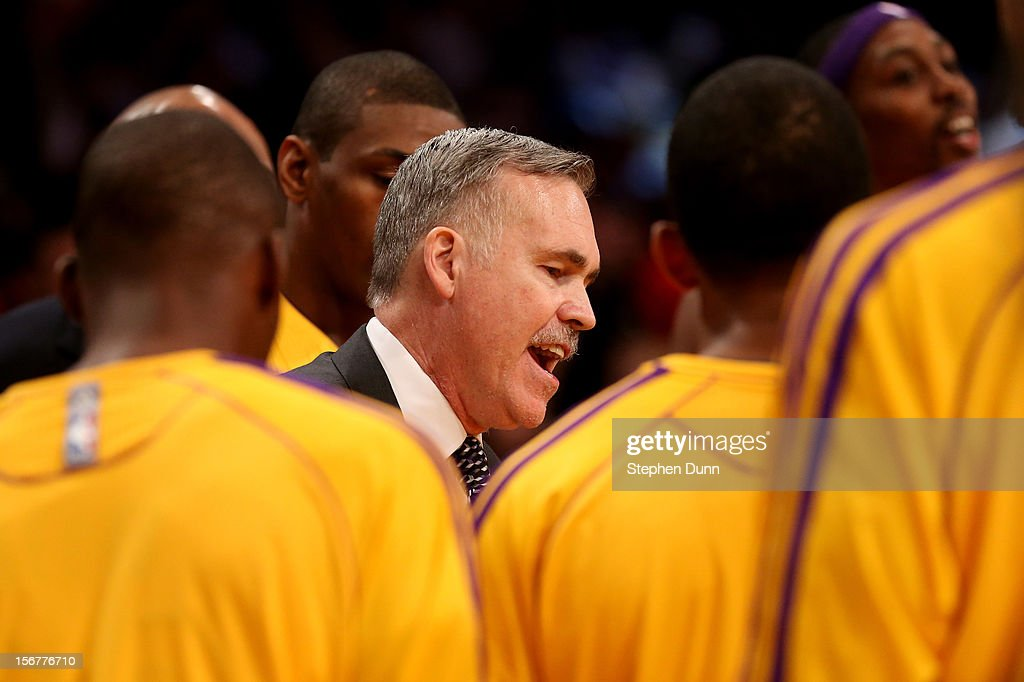 Head coach Mike D'Antoni of the Los Angeles Lakers gives instructions to his team before tipoff of the game against the Brooklyn Nets at Staples Center on November 20, 2012 in Los Angeles, California.