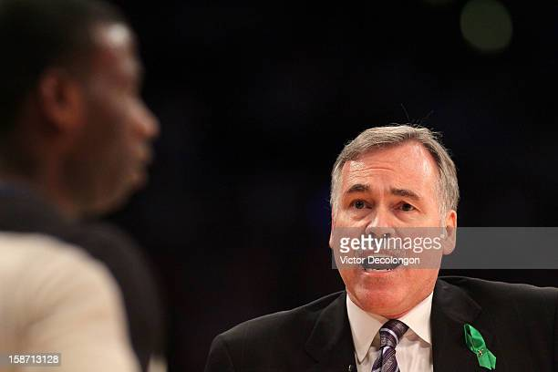 Head Coach Mike D'Antoni of the Los Angeles Lakers pleads his case with referee James Williams in the second half of the NBA game between the New...