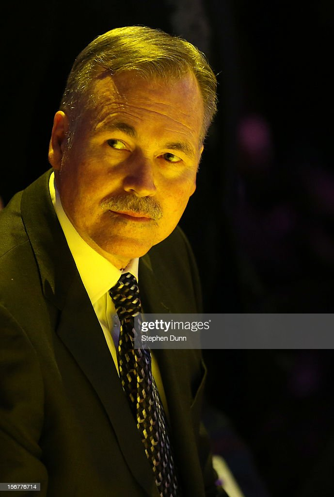 Head coach Mike D'Antoni of the Los Angeles Lakers sits on the bench during pregame introductions for the game against the Brooklyn Nets at Staples Center on November 20, 2012 in Los Angeles, California.