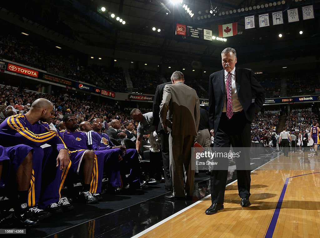Head coach Mike D'Antoni of the Los Angeles Lakers walks along the side of the court during a time out in their game against the Sacramento Kings at Power Balance Pavilion on November 21, 2012 in Sacramento, California.