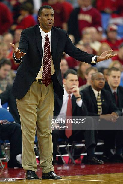 Head coach Mike Davis of the Indiana Hoosiers reacts during the game against the Kentucky Wildcats on December 20, 2003 at the RCA Dome in...