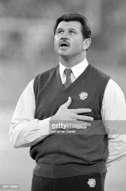 Head coach Mike Ditka of the Chicago Bears sings during the National Anthem before the game against the Detroit Lions at the Silverdome on December...