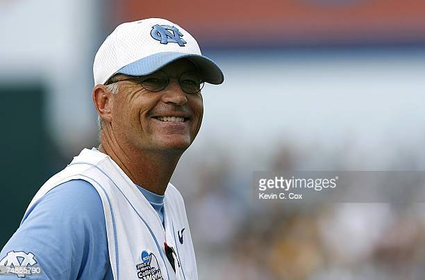 Head coach Mike Fox of the North Carolina Tar Heels smiles at some fans during their 7-4 win over the Rice Owls in Game 13 of the NCAA College World...