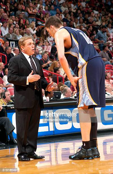 Head coach Mike Fratello of the Memphis Grizzlies talks to Pau Gasol during the game against the Miami Heat at American Airlines Arena on December 10...