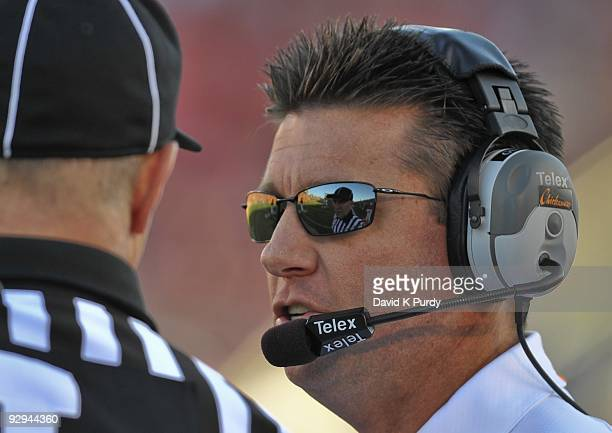 Head coach Mike Gundy of the Oklahoma State Cowboys speaks to an official during the game against the Iowa State Cyclones at Jack Trice Stadium on...
