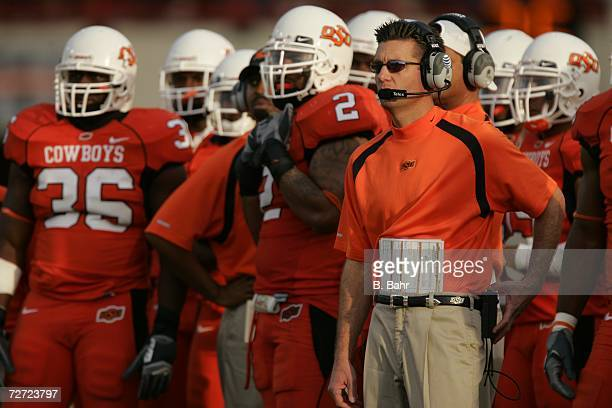 Head coach Mike Gundy of the Oklahoma State Cowboys waits for the results of an official's review in a game against the Oklahoma Sooners on November...