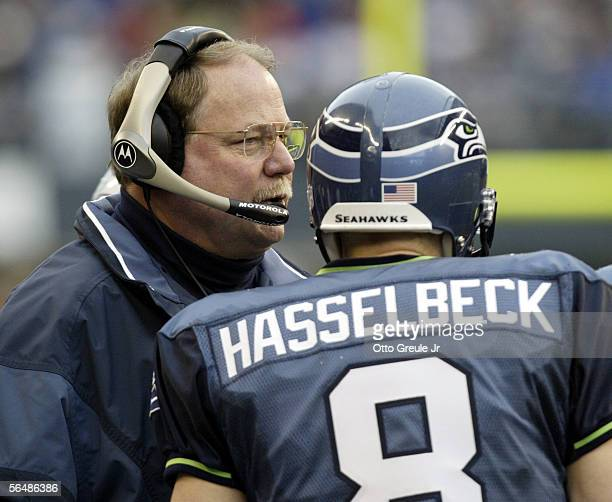 Head coach Mike Holmgren and quarterback Matt Hasselbeck of the Seattle Seahawks talk during a timeout in the third quarter of the game against the...