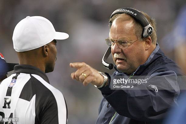 Head coach Mike Holmgren of the Seattle Seahawks argues with a referee during the game against the Oakland Raiders at Qwest Field on August 29 2008...