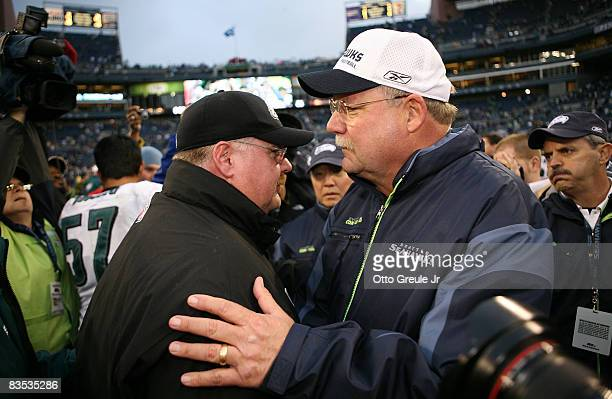 Head coach Mike Holmgren of the Seattle Seahawks congratulates head coach Andy Reid of the Philadelphia Eagles after the Eagles defeated the Seahawks...