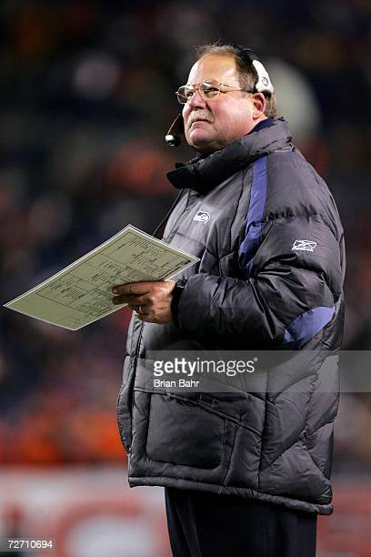 Head coach Mike Holmgren of the Seattle Seahawks looks up at the scoreboard against the Denver Broncos in the fourth quarter on December 3 2006 at...