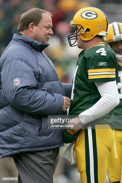 Head coach Mike Holmgren of the Seattle Seahawks talks to Brett Favre of the Green Bay Packers prior to their game January 1 2006 at Lambeau Field in...