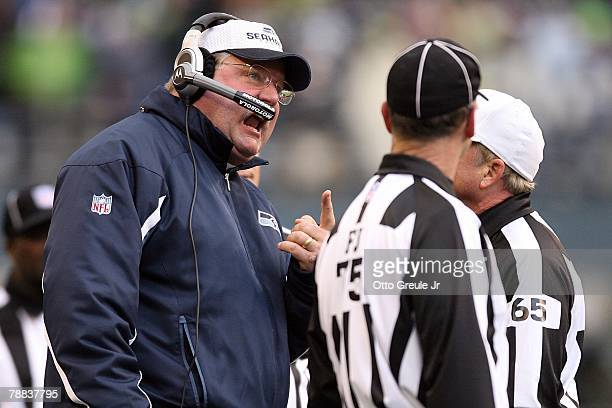 Head coach Mike Holmgren of the Seattle Seahawks talks to the officials during the game against the Washington Redskins during the NFC Wild Card game...