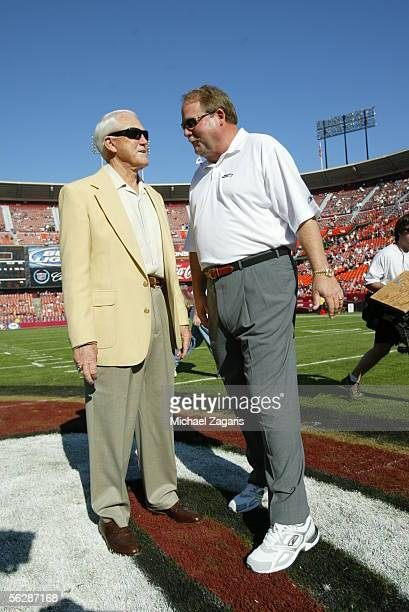 Head Coach Mike Holmgren of the Seattle Seahawks talks with former 49ers coach Bill Walsh before the game against the San Francisco 49ers at Monster...