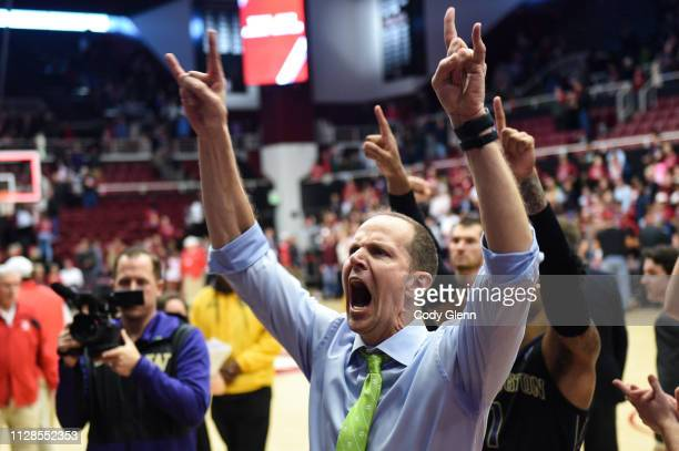Head coach Mike Hopkins of the Washington Huskies celebrates after their game against the Stanford Cardinal at Maples Pavilion on March 3, 2019 in...