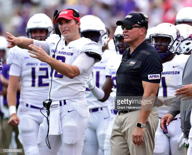 Head coach Mike Houston of the James Madison Dukes during their game against the North Carolina State Wolfpack at CarterFinley Stadium on September 1...