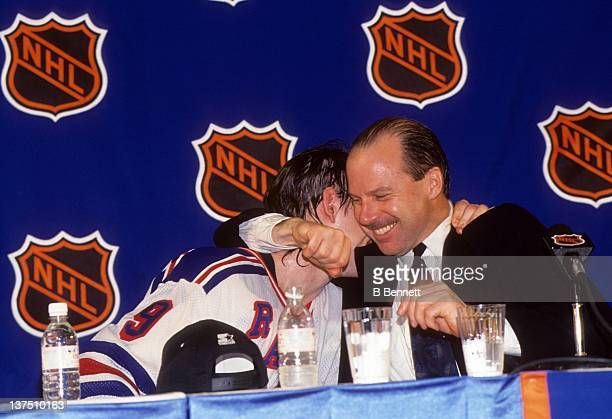 Head coach Mike Keenan of the New York Rangers hugs Adam Graves while they speak to the media after the Rangers defeated the Vancouver Canucks in...