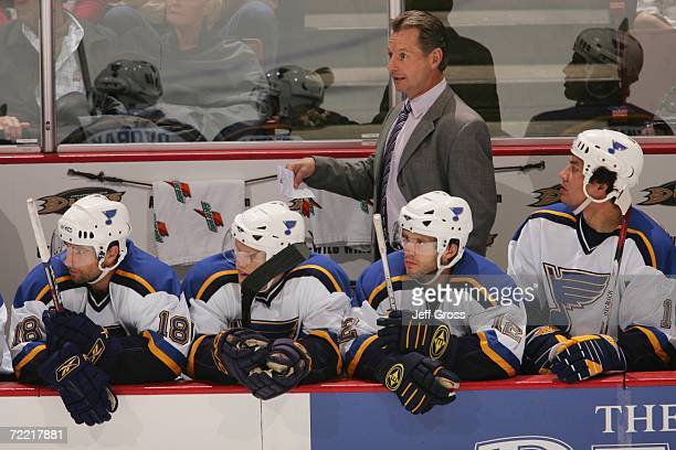 Head Coach Mike Kitchen of the St. Louis Blues looks on from behind the bench during the NHL game against the Anaheim Ducks at the Honda Center on...