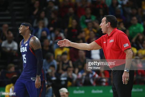 Head coach Mike Krzyzewsk of United States shouts as Carmelo Anthony reacts during the Men's Preliminary Round Group A between Australia and the...