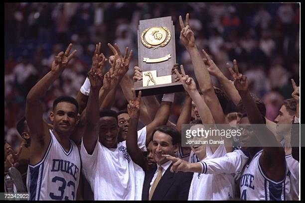Head coach Mike Krzyzewski and his Duke Blue Devils revel in their glory after winning their second consecetive NCAA basketball championship by...