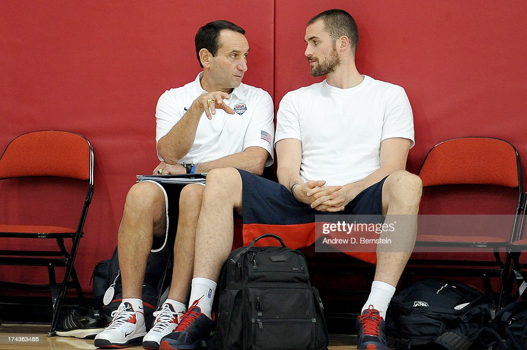 Head Coach Mike Krzyzewski and Kevin Love of the USA Basketball Men's National Team talk during practice at Training Camp at the Mendenhall Center on July 24, 2013, in Las Vegas, Nevada.