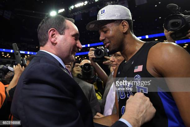 Head coach Mike Krzyzewski and Matt Jones of the Duke Blue Devils celebrate following their 7569 victory against the Notre Dame Fighting Irish during...