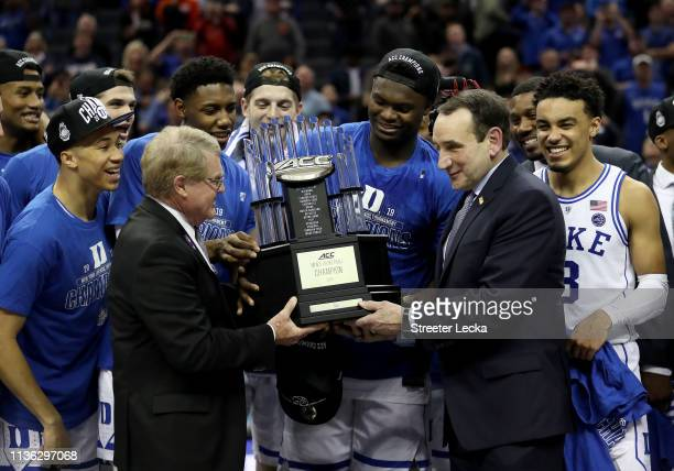Head coach Mike Krzyzewski of the Duke Blue Devils accepts the ACC Championship trophy after defeating the Florida State Seminoles 73-63 in the...