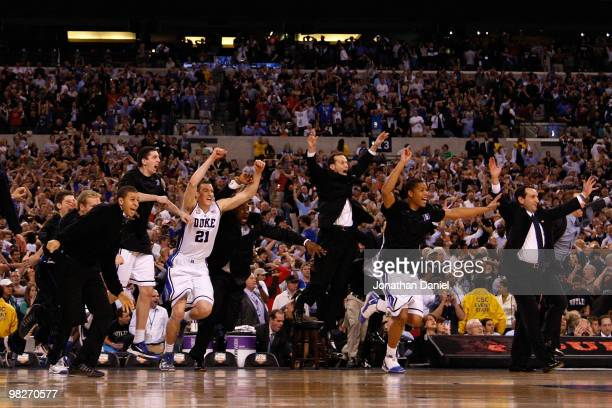 Head coach Mike Krzyzewski of the Duke Blue Devils and his players celebrate after they won 6159 against the Butler Bulldogs during the 2010 NCAA...