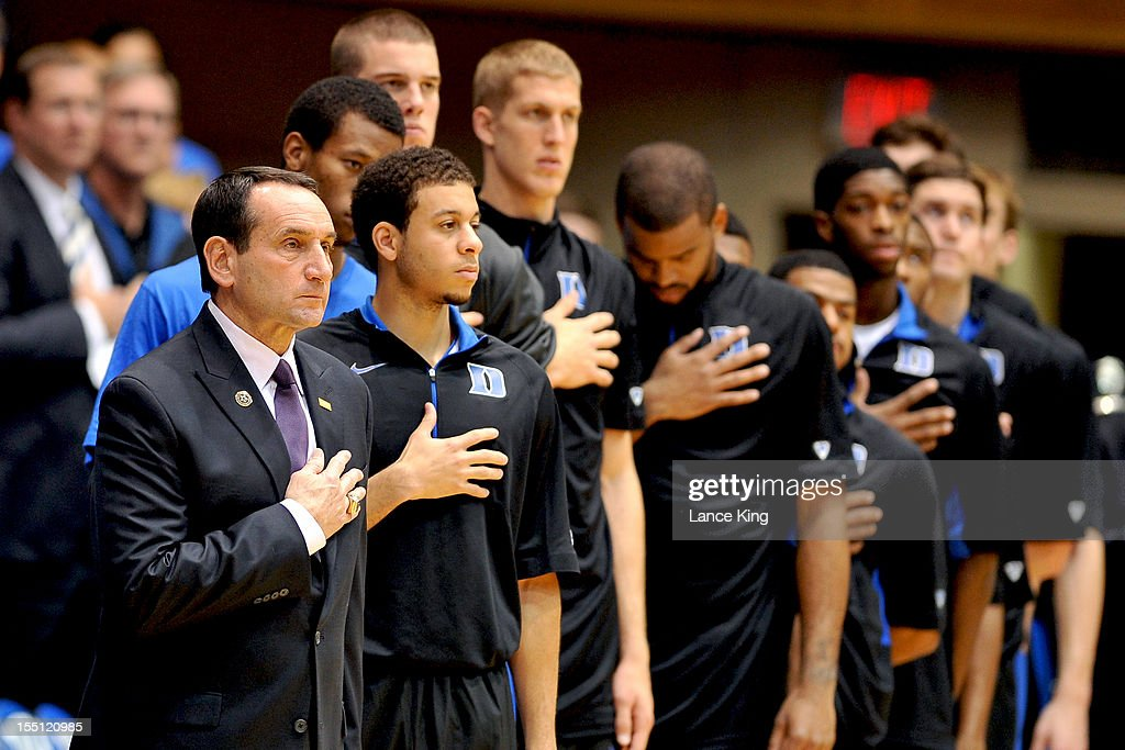 Head Coach Mike Krzyzewski of the Duke Blue Devils and players of his team stand at attention during the National Anthem prior to a game against the Winston-Salem State Rams at Cameron Indoor Stadium on November 1, 2012 in Durham, North Carolina. Duke defeated Winston-Salem State 69-44.
