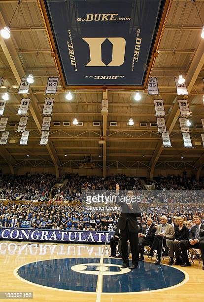 Head coach Mike Krzyzewski of the Duke Blue Devils celebrates with his family friends and fans as he is acknowledged for breaking the record for wins...