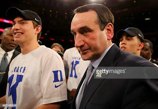 Head coach Mike Krzyzewski of the Duke Blue Devils celebrates with his players and coaches after the win over the St John's Red Storm at Madison...