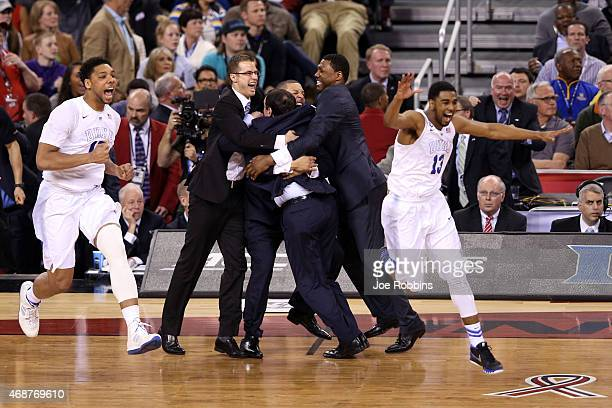 Head coach Mike Krzyzewski of the Duke Blue Devils celebrates with his team after defeating the Wisconsin Badgers during the NCAA Men's Final Four...