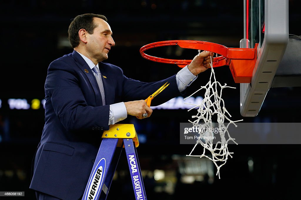 Head coach Mike Krzyzewski of the Duke Blue Devils cuts down the net after defeating the Gonzaga Bulldogs 66-52 in the South Regional Final of the 2015 NCAA Men's Basketball Tournament at NRG Stadium on March 29, 2015 in Houston, Texas.