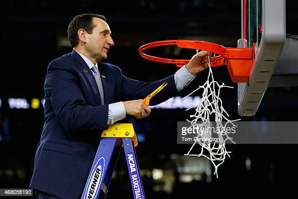 Head coach Mike Krzyzewski of the Duke Blue Devils cuts down the net after defeating the Gonzaga Bulldogs 6652 in the South Regional Final of the...