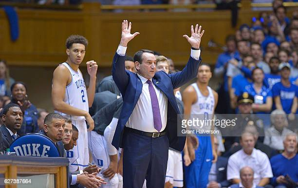 Head coach Mike Krzyzewski of the Duke Blue Devils directs his team against the Michigan State Spartans during the game at Cameron Indoor Stadium on...