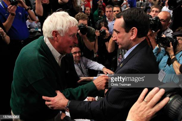 Head coach Mike Krzyzewski of the Duke Blue Devils embraces Bobby Knight after winning his 903 NCAA Division 1 basketball game and becoming the...
