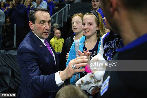 Head coach Mike Krzyzewski of the Duke Blue Devils greets fans after defeating the Yale Bulldogs 71-64 during the second round of the 2016 NCAA Men's...