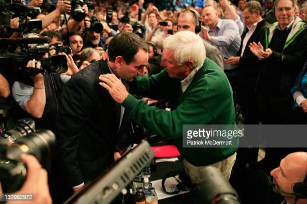 Head coach Mike Krzyzewski of the Duke Blue Devils hugs Bob Knight after winning his 903rd game and passing him to become the all-time winningest...