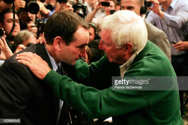 Head coach Mike Krzyzewski of the Duke Blue Devils hugs Bob Knight after winning his 903rd game and passing him to become the alltime winningest...