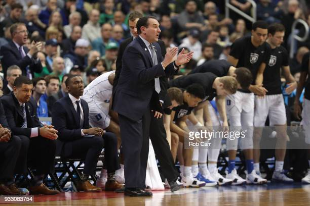 Head coach Mike Krzyzewski of the Duke Blue Devils reacts against the Rhode Island Rams during the first half in the second round of the 2018 NCAA...