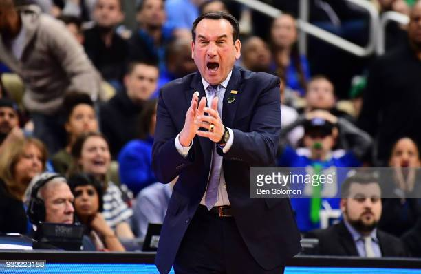 head coach Mike Krzyzewski of the Duke Blue Devils reacts to a play in the first half during the game against Rhode Island Rams in the second round...